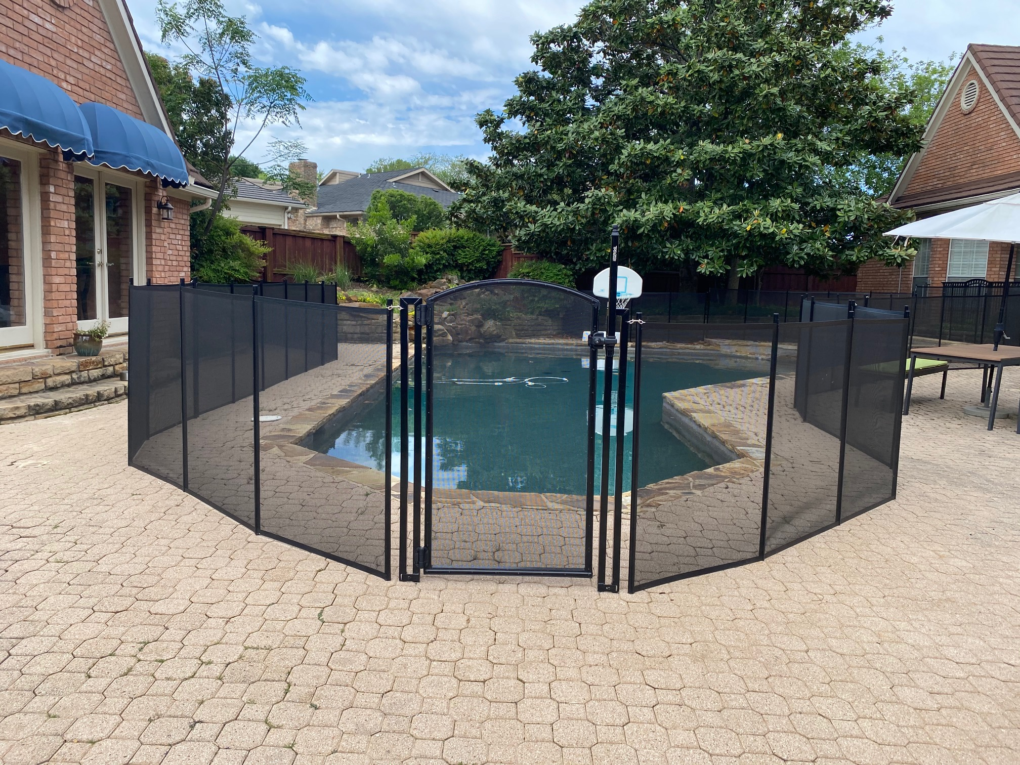 black mesh pool fence installed in Irving, TX